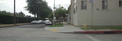 Left Side view of a Driving Plate. Car travels through a residential area on El Stock Footage