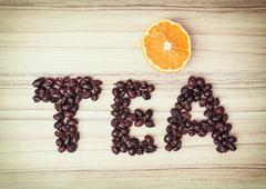 Title TEA composited of the dried rosehips with sliced orange Stock Photos