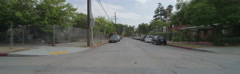 Rear view of a Driving Plate. Car travels through a residential area on El Stock Footage
