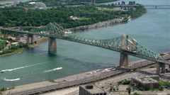 Flying over Jacques Cartier Bridge in Montreal, Quebec. Shot in 2003. Stock Footage
