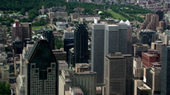 Flying past skyscrapers toward green space in Montreal, Quebec. Shot in 2003. Stock Footage
