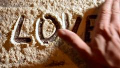 Write love on flour closeup Stock Footage