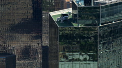 Partial orbit of shiny tower and older buildings - stock footage