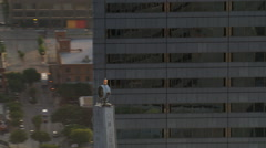 Close flight past granite grid and golden tower Stock Footage