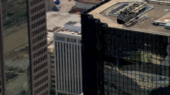 Flying around skyscraper roofline Stock Footage