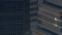 Partial orbit of glass and granite skyscraper - stock footage