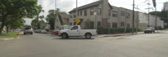Left Side view of a Driving Plate. Car turns left from Gower Street onto Yucca Stock Footage