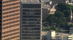 Close orbit of skyscrapers and historic church Stock Footage
