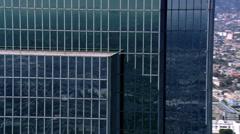 Close flight near skyscraper's frame-filling glass grid Stock Footage