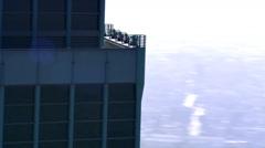 Speedy orbit of skyscraper's top - stock footage
