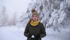 Girl throwing a snowball - stock footage