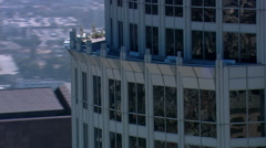 Partial orbit of steel and glass skyscraper - stock footage