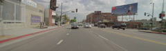 Rear view of a Driving Plate: Car travels on Cahuenga Boulevard in Los Angeles Stock Footage