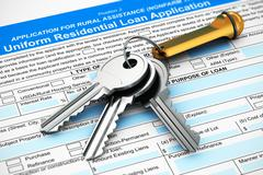 Bunch of house keys on mortgage or loan application form Stock Photos