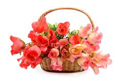 basket with colorful artificial flowers - stock photo
