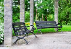 Bench  to rest in a beautiful park Stock Photos