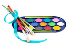 Kit of watercolor paints and brushes for painting Stock Photos
