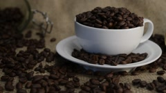 Cup full of Arabica coffee beans - stock footage