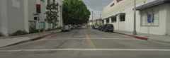 Right Side view of a Driving Plate: Car travels on Wilshire Boulevard from Stock Footage
