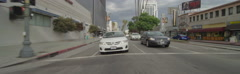 Rear view of a Driving Plate: Car travels on Wilshire Boulevard from Dunsmuir Stock Footage