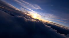 Flying through clouds toward setting sun Stock Footage