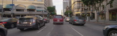 Front view of a Driving Plate: Car travels on Figueroa Street in Los Angeles Stock Footage