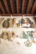 Fresco damaged to be restored in a medieval cloister. - stock photo