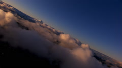 Veering flight over fluffy clouds Stock Footage