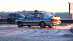 Russian road police car stand at winter city street, slow motion shot Stock Footage