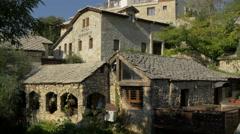 View of hotel Kriva Cuprija and Konoba Taurus restaurant in Mostar Stock Footage