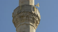 View of sculptures and a loudspeaker on the minaret of a mosque in Mostar Stock Footage