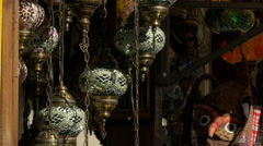 View of hanged censers in the wind and a mask in Mostar Stock Footage