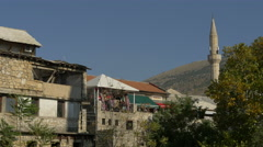 Stock Video Footage of View buildings made of stone and a balcony with scarves in the wind at Mostar