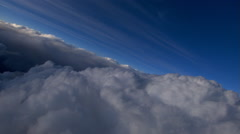Flying over cumulus with thinner streaks above - stock footage