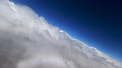Veering flight over puffy clouds, precipitation on lens Stock Footage