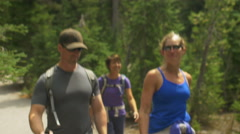 Group of friends smile and talk while hiking - stock footage
