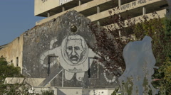Graffiti of an astronaut on a wall near the public toilet and in Mostar - stock footage