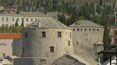 Towers of Stari Most and advertising signs in Mostar Stock Footage