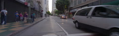 Rear view of a Driving Plate: Car turns right from 6th Street onto South Stock Footage