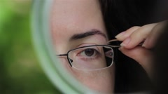 Make-up of the girl - is pulled out by eyebrows. A girl eyebrow shaping 4 - stock footage