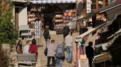 Stock Video Footage of Tourists walking on a cobblestone street in Mostar, Bosnia-Herzegovina
