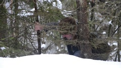 Man with an ax cut a tree in a cold snowy winter 23 Stock Footage