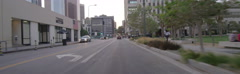 Front view of a Driving Plate: Car turns right from Spring Street onto 2nd Stock Footage