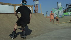 Guy Riding on Roller Skates on a Ramp Stock Footage