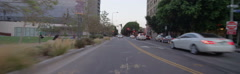 Rear view of a Driving Plate: Car turns right from Spring Street onto 2nd Street Stock Footage