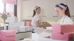 4K Female business partners in home bakery business preparing deliveries Stock Footage