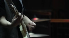 On stage a concert a boy playing guitar. They see and drums - stock footage