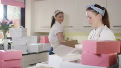 4K Female business partners in home bakery business preparing deliveries - stock footage
