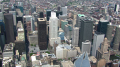 Flying over downtown Chicago buildings and river bridges. Shot in 2003. Stock Footage