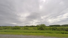Movement of clouds over a dirt road. Lubinsky District, Omsk Region, Russia,  Stock Footage
